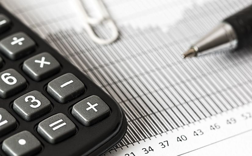 Title Image of Your Liability During an Economic Downturn showing a calculator, a pen, and a piece of paper.