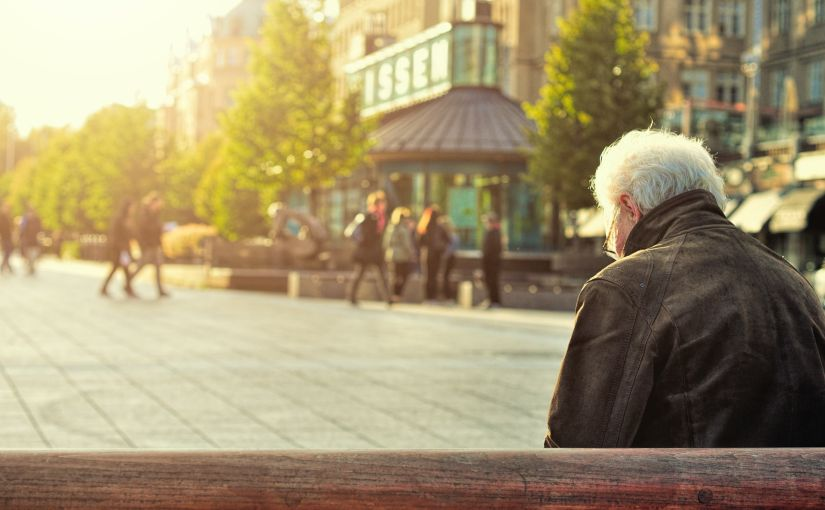 Title image for Coordinate Retiree Health Benefits with Medicare Eligibility showing an elderly man sitting on a bench enjoying the sunny afternoon.