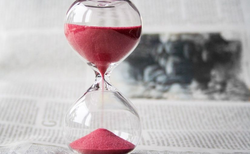Title image for The First 24 Hours After an Injury showing an hourglass with pink colored sand running down.