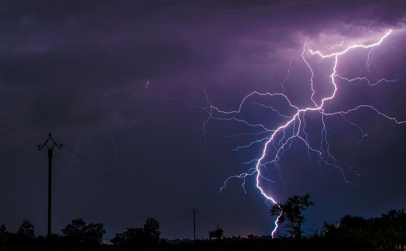 Title image for Named Storm Deductibles showing lightning striking the ground during a storm.