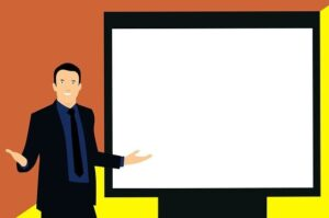 Image for Training for Employees Supervisors and Managers showing a man in a suit doing a presentation with a white board.